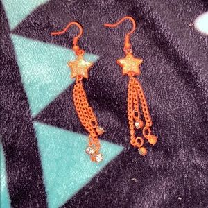Orange star dangle earrings